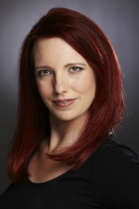 Colour studio shot of Gillian Dean with bright red hair